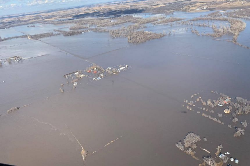 Flooded apartments are seen over Elkhorn River after a storm triggered historic flooding in Nebraska, on March 16, 2019.