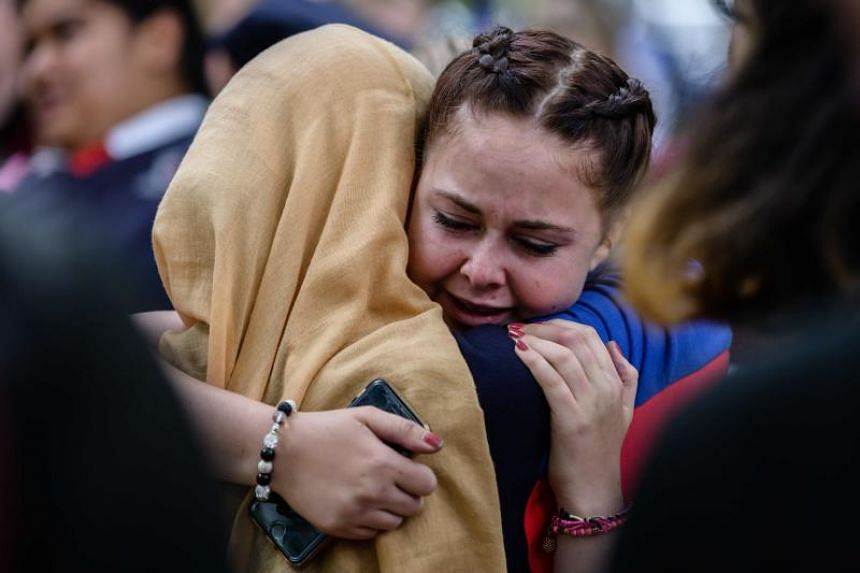 Students comforting each other during a vigil in Christchurch on March 18, 2019, three days after a shooting incident at two mosques in the city that claimed the lives of 50 Muslim worshippers.