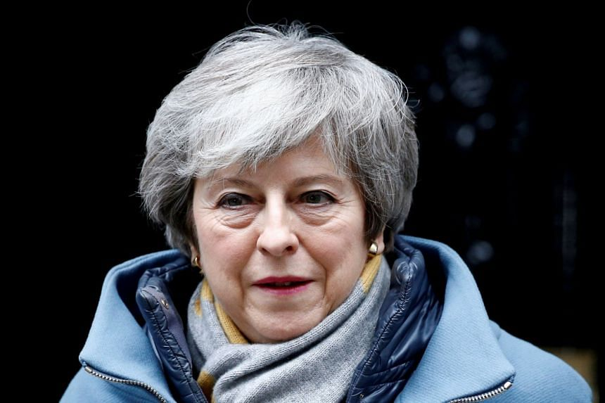 British Prime Minister Theresa May walks outside Downing Street, as she faces a vote on Brexit, in London, Britain, on March 13, 2019.