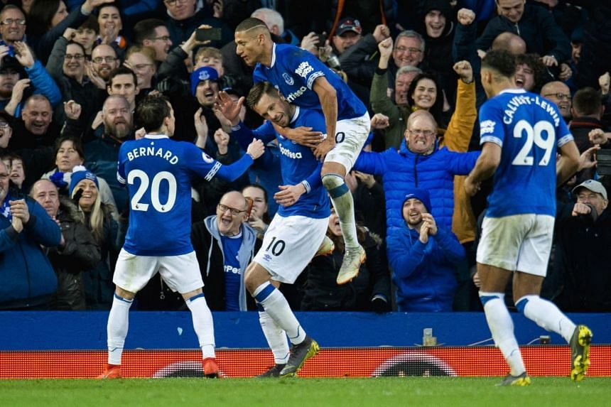 Everton's Gylfi Sigurdsson (10) is congratulated after scoring the second goal during the English Premier League match against Chelsea, on March 17, 2019.