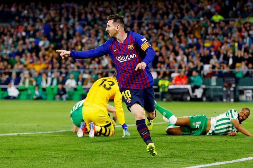 Barcelona's Lionel Messi celebrates after scoring his first goal against Betis, on March 17, 2019.
