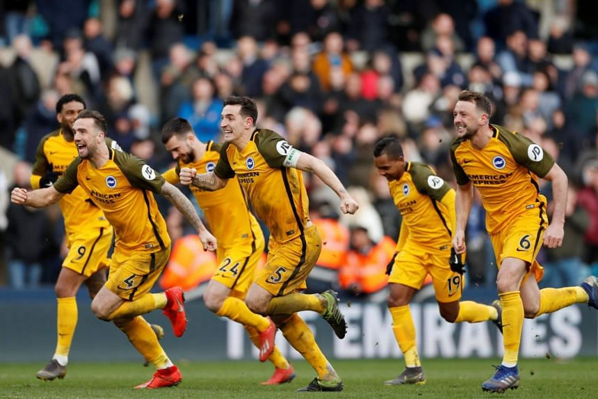 Brighton players celebrate on the pitch after beating Millwall to reach their first FA Cup semi-final since 1983.