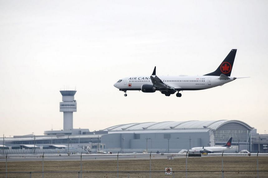 An Air Canada Boeing 737 Max jet approaches Toronto Pearson International Airport, on March 13, 2019.