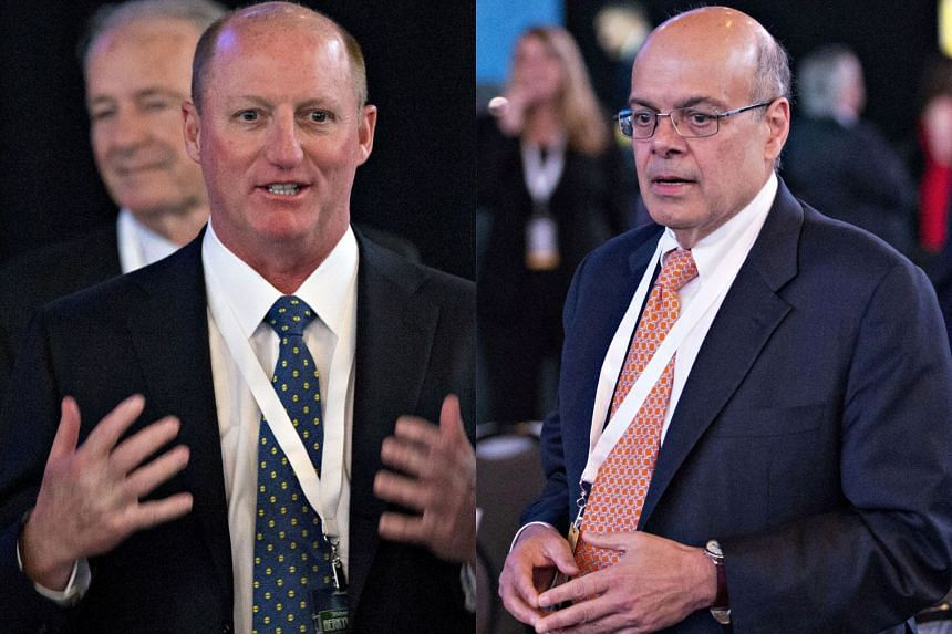 Berkshire Hathaway vice-chairmen Greg Abel (left) and Ajit Jain are considered the leading candidates to succeed Mr Warren Buffett as the conglomerate's chief executive.
