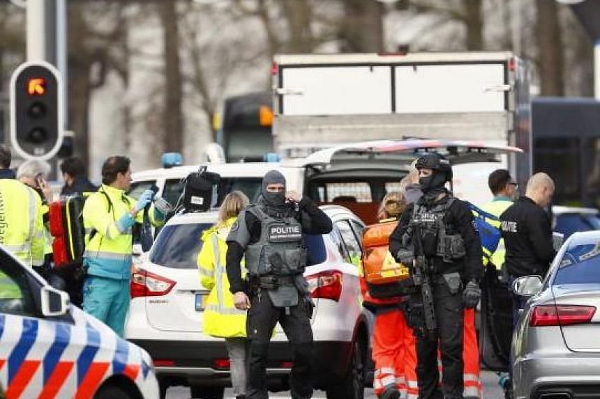 Emergency services stand at the 24 Oktoberplace in Utrecht, Netherlands, where a shooting took place on March 18, 2019.