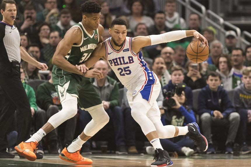 Philadelphia 76ers guard Ben Simmons (right) moves to the basket against Milwaukee Bucks forward Giannis Antetokounmpo during the first quarter at Fiserv Forum.