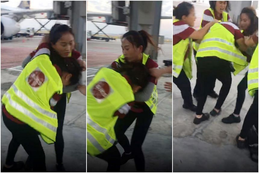 Sats said it is conducting a thorough investigation of the incident in which two employees - both women - are seen hitting each other.