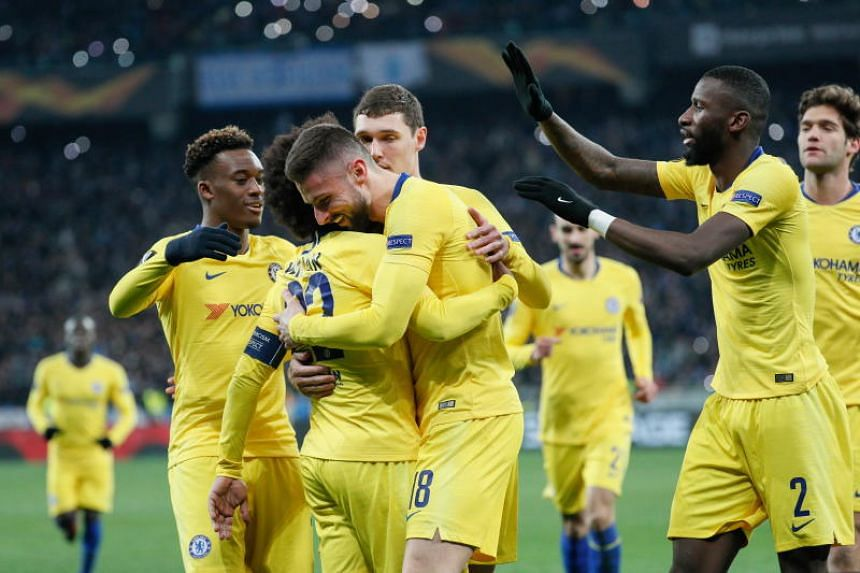 Chelsea players celebrate during the UEFA Europa League football match between FC Dynamo Kyiv and Chelsea FC in Kiev, Ukraine, on March 14, 2019.