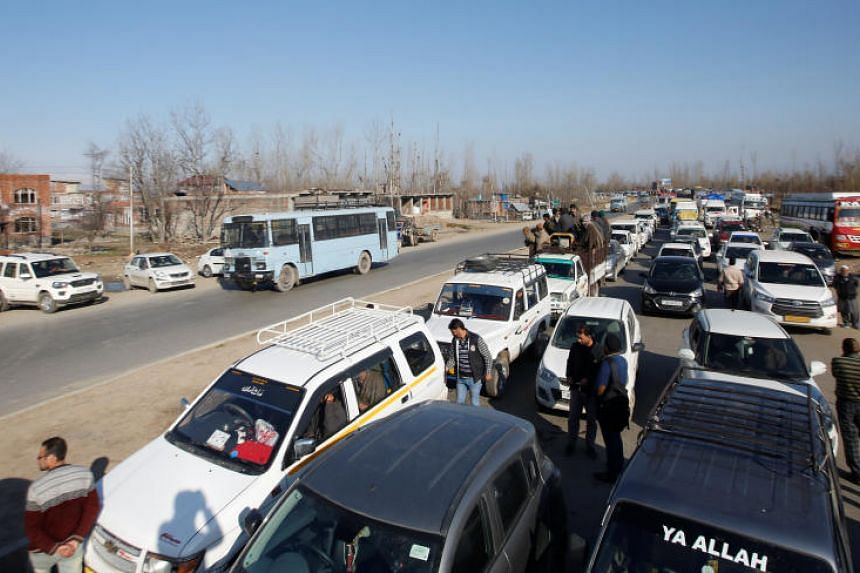 Traffic is stopped as the Indian Central Reserve Police Force convoy moves along a national highway in Qazigund, on March 18, 2019.