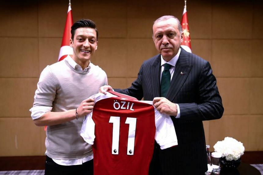 Arsenal midfielder Mesut Ozil (left) was photographed with Turkish President Recep Tayyip Erdogan (right) on the eve of Germany's disastrous World Cup campaign, raising questions about the footballer's loyalty.