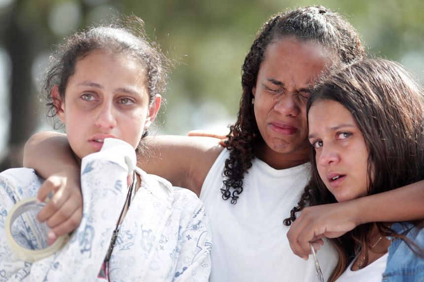 Students cry during a tribute to victims of the shooting in Suzano, on March 19, 2019.