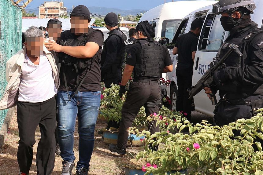 Malaysian security officers arresting a suspected militant in Sabah in the latest anti-terror raids.