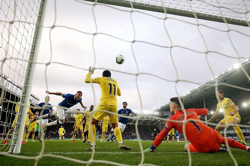 Everton's Richarlison heading home their first goal against Chelsea at Goodison Park. The Brazilian's 12th league goal of the season set the Toffees on their way to a 2-0 win, their first over a top-six side since January 2017.