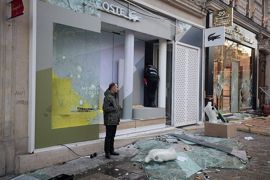 Vandals left hardly a storefront or cafe unscathed as they broke windows and looted luxury stores along the famed Champs Elysees avenue in Paris last Saturday.