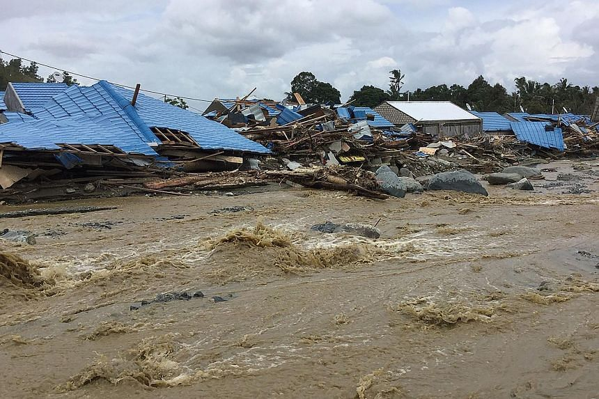 Flash floods last Saturday destroyed hundreds of houses and left vehicles submerged in mud in Sentani. Two bridges were washed away, as were large trees and even a light aircraft.