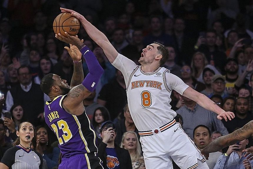 Knicks forward Mario Hezonja blocking Lakers forward LeBron James' shot at the buzzer in the Knicks' 124-123 victory at Madison Square Garden. James missed his final four field-goal attempts.