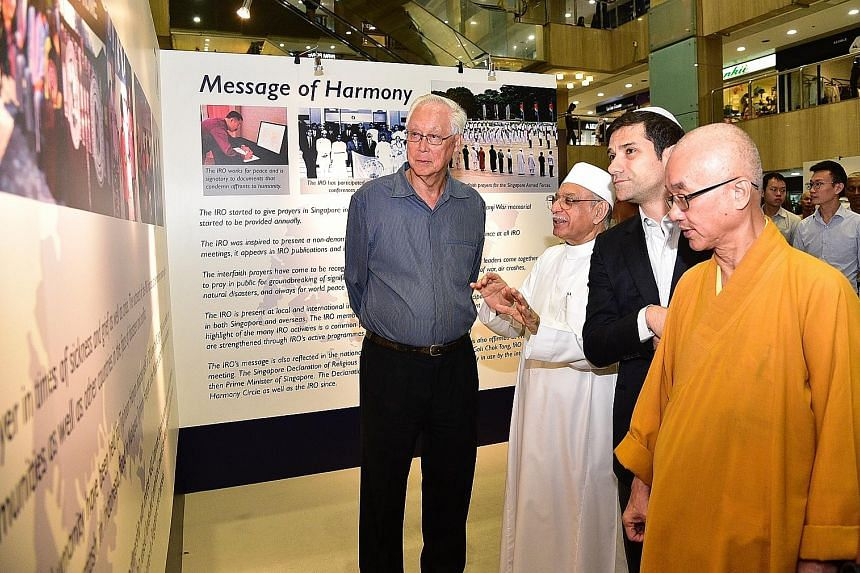 (From left) Emeritus Senior Minister Goh Chok Tong, who is patron of the Inter-Religious Organisation, Singapore with religious leaders, Imam Habib Hassan Al-Attas, Mr Ben J. Benjamin and Venerable Seck Kwang Phing, at the launch yesterday of an exhi