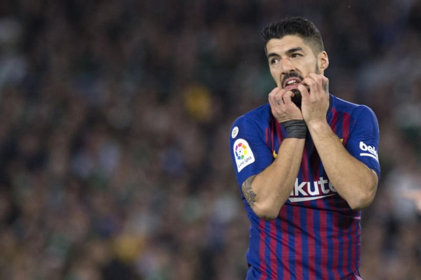 Barcelona forward Luis Suarez is expected to miss between 10 and 15 days after limping off late in Sunday's (March 17) 4-1 win at Real Betis in La Liga.