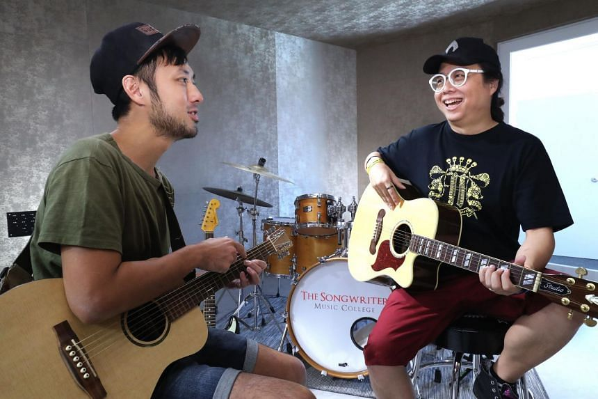 """Local music veteran Eric Ng (right) gave singer-songwriter Angus Sham the challenge of composing 10 songs in 10 days, and eventually picked the latter's creation """"Thank You For Saying Goodbye"""" for a """"makeover""""."""