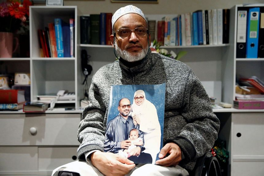 Al Noor mosque shooting survivor Farhid Ahmed poses with a photo of his wife Husna, who was killed in the attack.