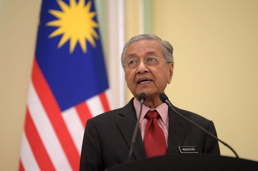 Malaysian Prime Minister Mahathir Mohamad attends a press conference at the Malaysian Prime Minister's Office.