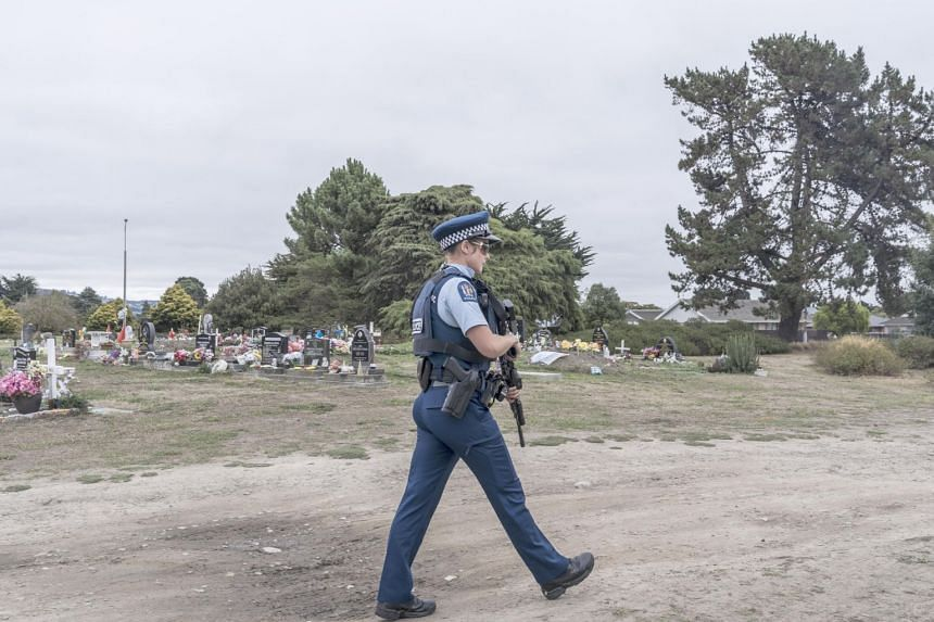 Police patrol the Memorial Park Cemetery in Christchurch, New Zealand, where 50 people were killed during a terrorist attack at two mosques.