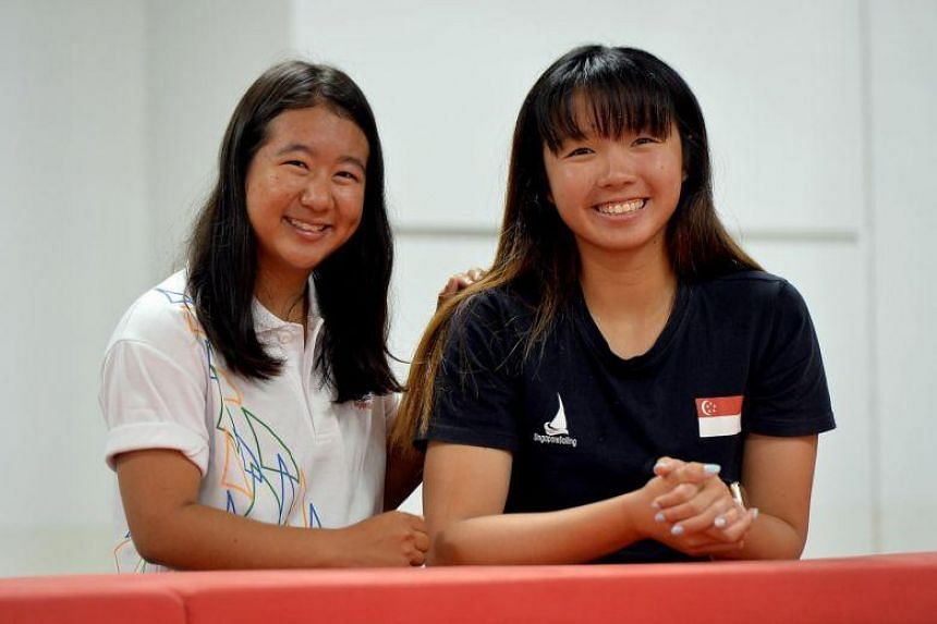 National sailors Yukie Yokoyama (left) and Cheryl Teo. During a training camp in Okinawa in February 2018, a four-metre wave washed over the women's 470 duo's boat and caused it to capsize.
