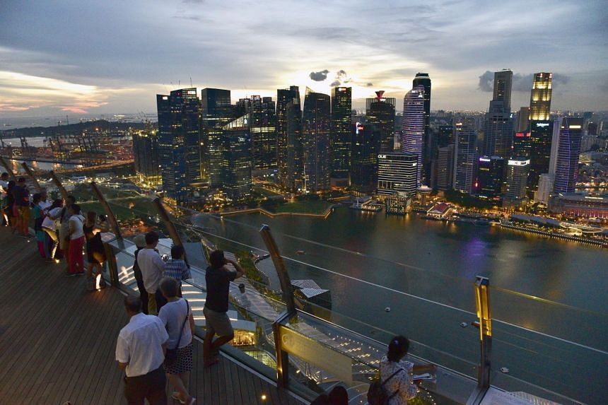 Paris and Hong Kong joined Singapore (pictured) as the world's most expensive cities to live in. It was the first time in more than 30 years that three cities shared the top spot.