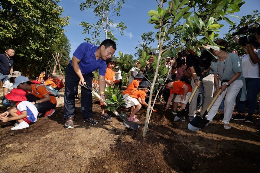 Minister for Social and Family Development and Second Minister for National Development Desmond Lee opening the Nature Playgarden with a tree-planting ceremony at HortPark on March 19, 2019.