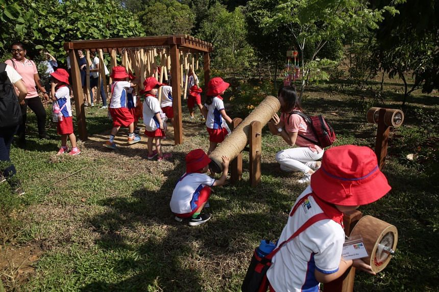 Preschool pupils playing in the new Nature Playgarden at HortPark on March 19, 2019.