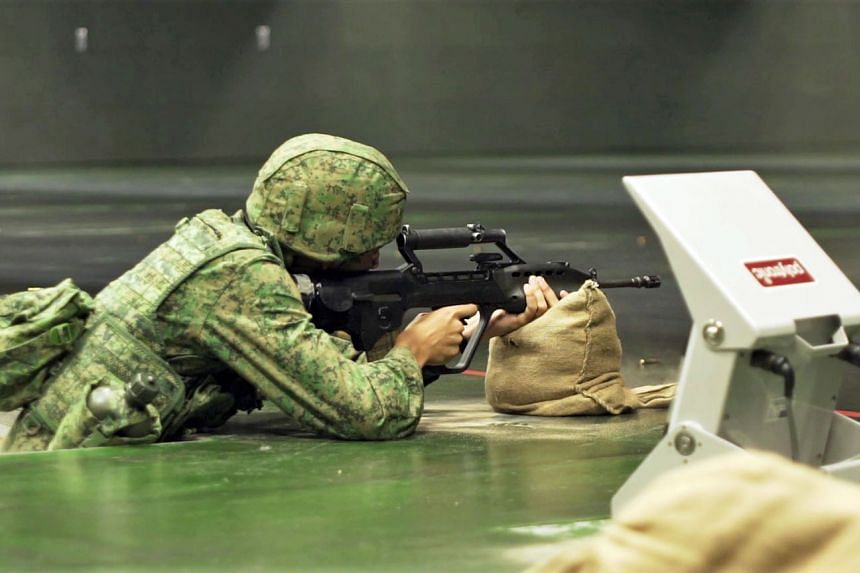 Soldiers graded PES E, who typically serve as administrative support or supply assistants, can now try out the SAR21 assault rifle using an indoor virtual firing range.