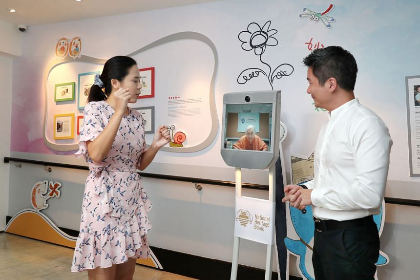 Mr Alvin Tan, assistant chief executive of the National Heritage Board, and Ms Lu Cai Xia, assistant curator of the Sun Yat Sen Nanyang Memorial Hall, with the remote-controlled Telepresence Robot. With the robot, a visitor needs only a device with a