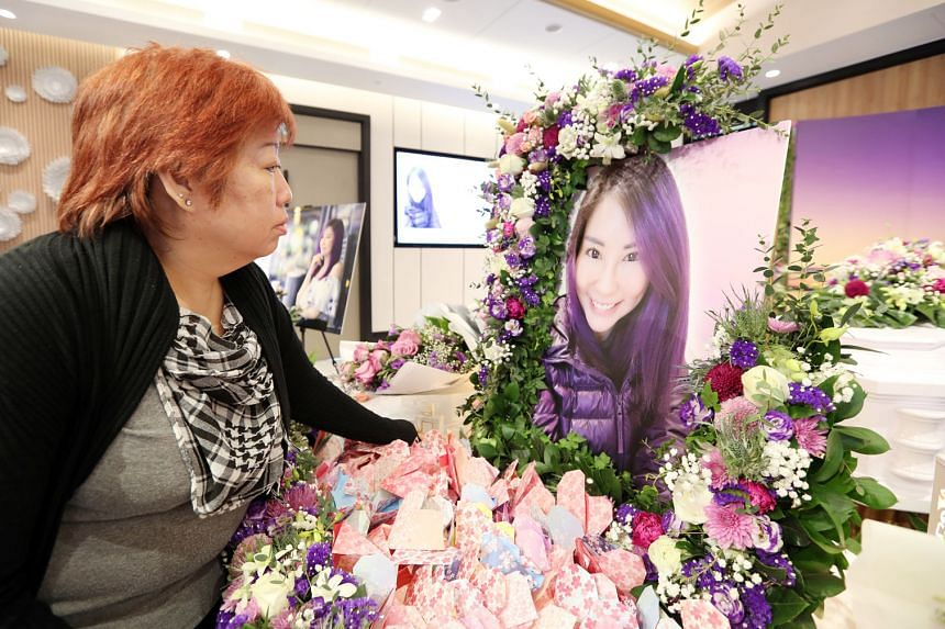 Ms Lau Li Ting's mother at the wake held in Tampines last week. Ms Lau had gone for Botox treatment at a clinic on the fringe of the business district and ended up in the accident and emergency department of SGH on March 8. Doctors told her family he
