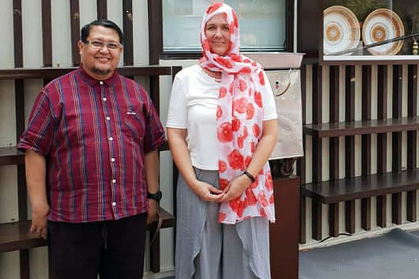 Mr Graeme Merrall with Al-Falah Mosque's Ms Noor Khairiyah Abdul Rahman, and Mrs Kim Forrester (above) with Al-Huda Mosque chairman Azman Kassim. Both New Zealanders felt compelled to visit Singapore mosques after the Christchurch attacks to express