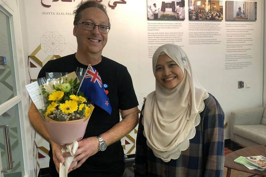 Mr Graeme Merrall (above) with Al-Falah Mosque's Ms Noor Khairiyah Abdul Rahman, and Mrs Kim Forrester with Al-Huda Mosque chairman Azman Kassim. Both New Zealanders felt compelled to visit Singapore mosques after the Christchurch attacks to express