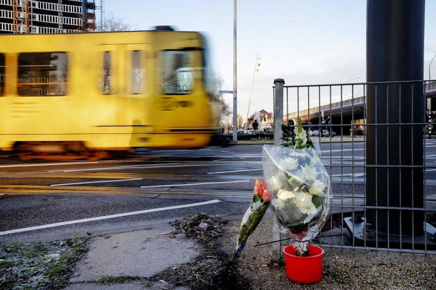 Flowers placed near the scene of the fatal shooting that took place at 24 Oktoberplein, in Utrecht, The Netherlands, on March 18.