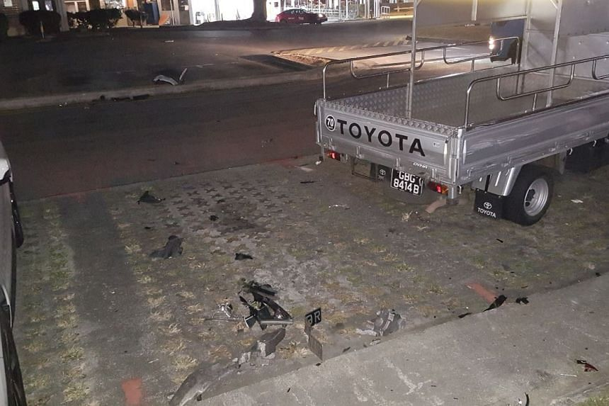 Debris littering the ground in a Bedok carpark after a taxi crashed into a car and two lorries there.