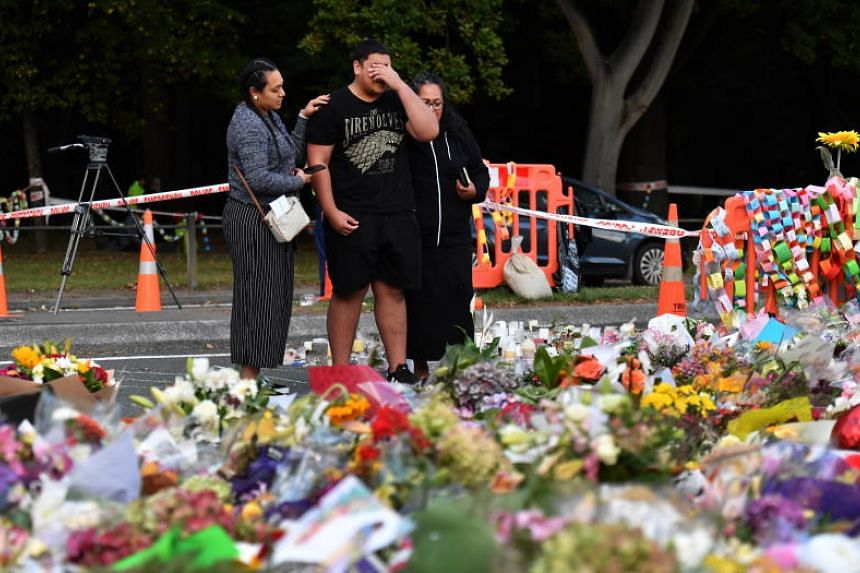 Members of the public grieve at a makeshift memorial at the Al Noor Mosque on Deans Rd in Christchurch, New Zealand, on March 19, 2019.
