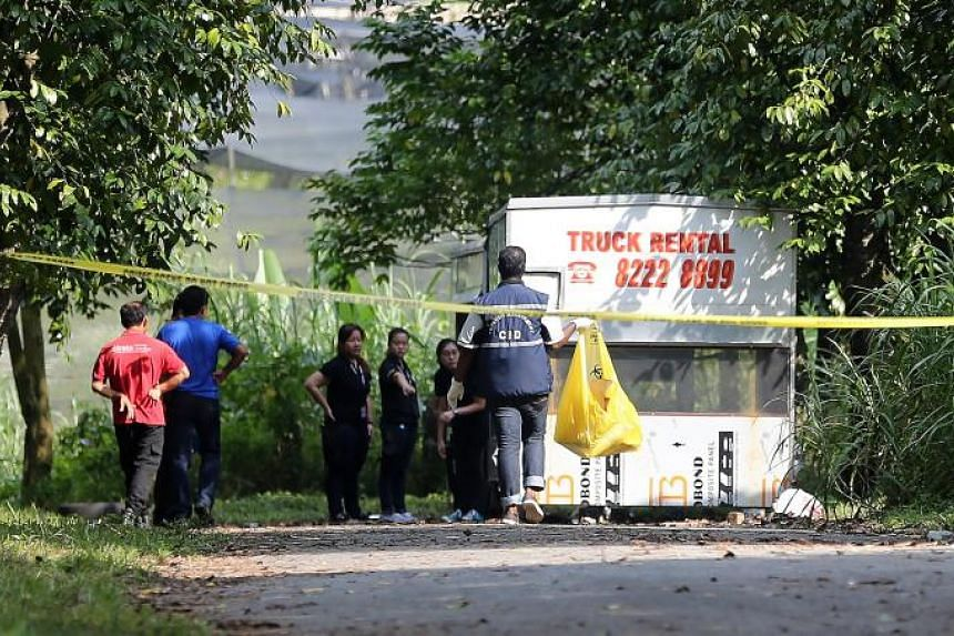 Police investigators at the site at Lim Chu Kang Lane 8 where Ms Cui Yajie's decomposed remains were found on July 21, 2016.