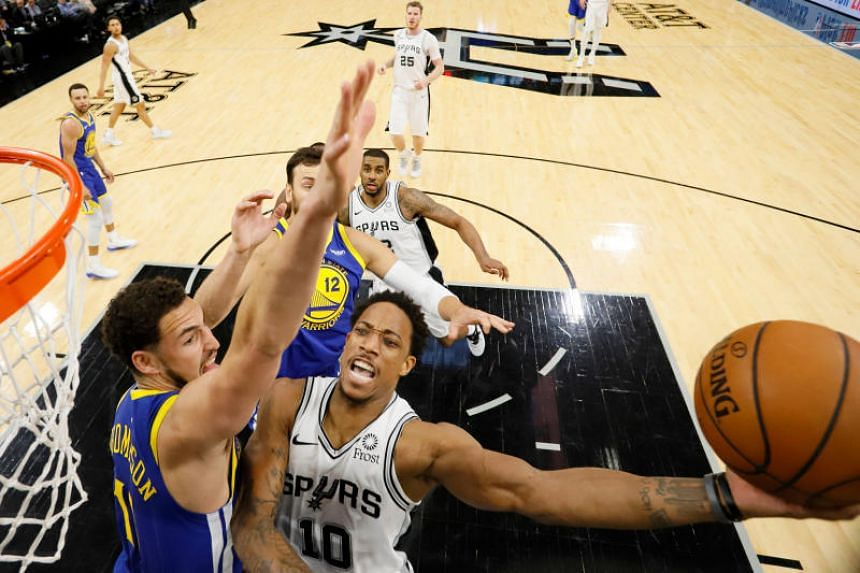 San Antonio Spurs shooting guard DeMar DeRozan (right) shoots the ball as Golden State Warriors shooting guard Klay Thompson defends during the second half at AT&T Center on March 18, 2019.