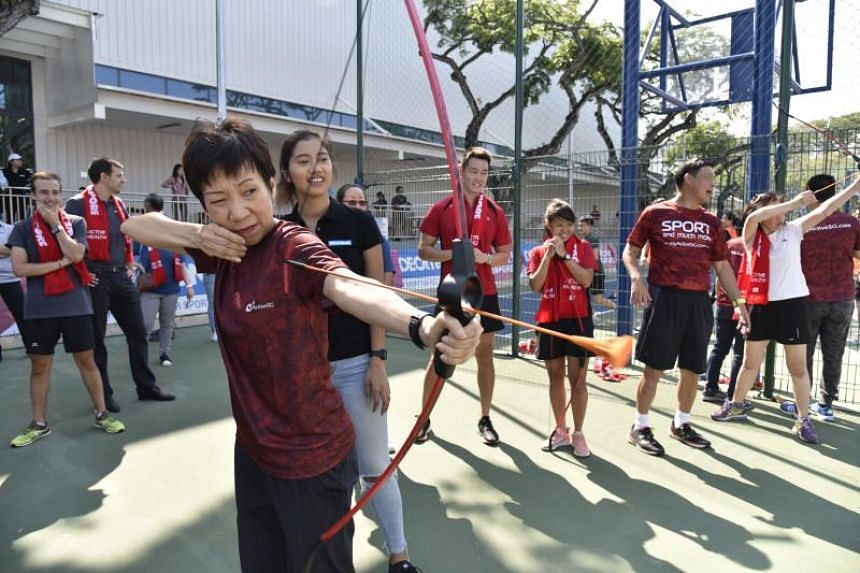 Minister for Culture, Community and Youth Grace Fu taking part in a sports day on March 19 at Decathlon Singapore Lab.