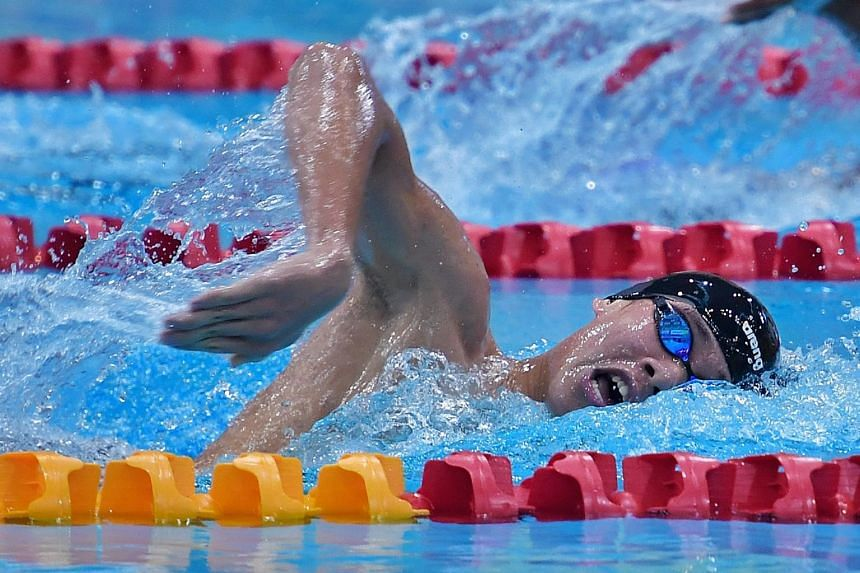 National swimmer Glen Lim clocked 8min 10.33sec at the OCBC Aquatic Centre to finish second to Indonesia's Aflah Fadlan Prawira (8:04.29), improving the previous record of 8:11.59 he set at last year's Asian Games.