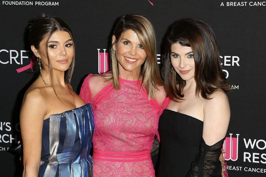 Full House actress Lori Loughlin (centre) with daughters Olivia Jade (left) and Isabella.
