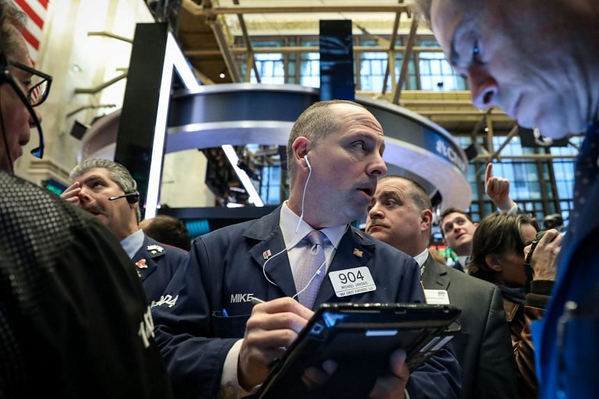 Traders work on the floor of the New York Stock Exchange, March 11, 2019.