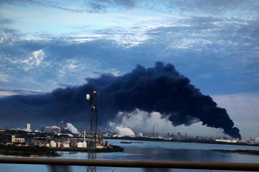Smoke rises from a fire burning at the Intercontinental Terminals Company.