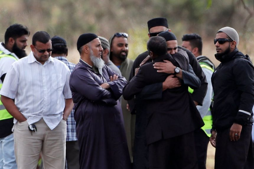 Relatives and other people arrive to attend the burial ceremony of the victims of the mosque attacks.