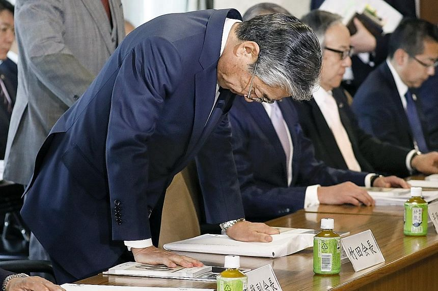 Tsunekazu Takeda, the head of the Japanese Olympic Committee (JOC), bowing before a JOC board meeting in Tokyo yesterday. He is being investigated by French authorities for corruption linked to the 2020 Olympic Games bid.
