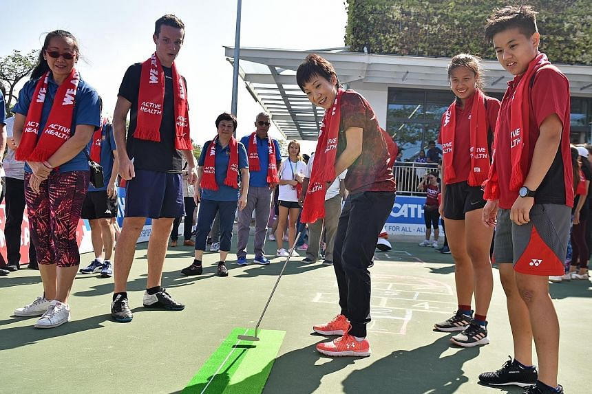 Grace Fu, Minister for Culture, Community and Youth putting during a sports day yesterday at Decathlon Singapore Lab in Kallang. She was the guest of honour as GetActive! Singapore announced the return of the Pesta Sukan this year from Aug 1-10.