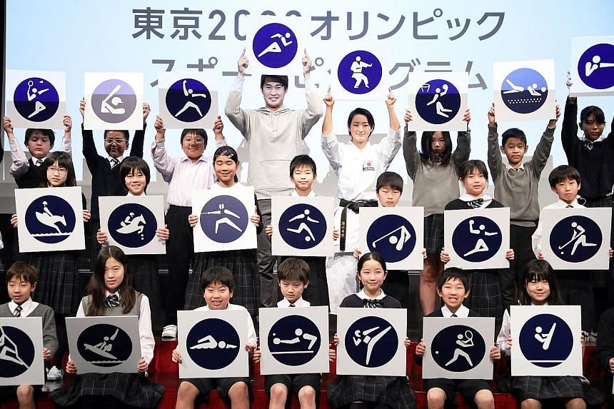 Japanese athletes and school children coming together to display the Tokyo 2020 sports pictograms during an event in Tokyo last week. Japan is an hour ahead of Singapore, which means that the 2020 Olympic Games will be held at optimal timing for view