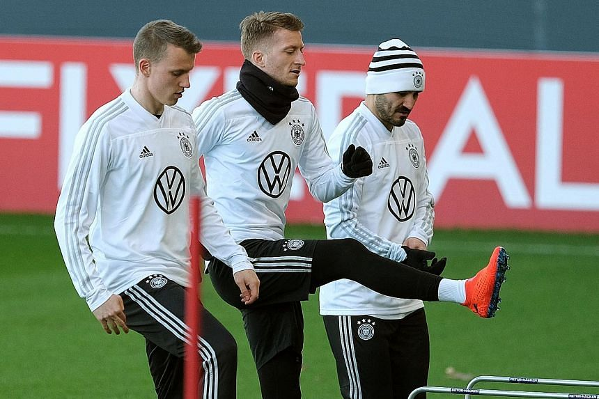 From left: Lukas Klostermann, Marco Reus and Ilkay Gundogan are part of a revamped German team bidding to improve on a lacklustre 2018. Germany will host Serbia in a friendly match today before their opening Euro 2020 qualifier against the Netherland